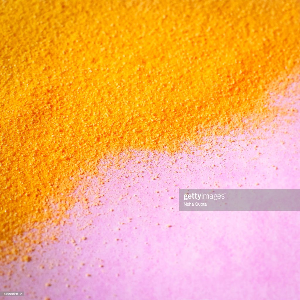 orange colored sand pink background stock photo getty images
