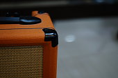 selective focus orange guitar speaker box