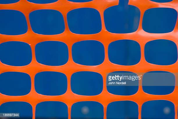 orange construction fence around a new york city street construction site - 待避所標識 ストックフォトと画像