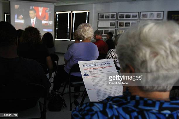 Orange County Democrats gather at an International Brotherhood of Electrical Workers Union Hall to watch President Barack Obama gives his health-care...