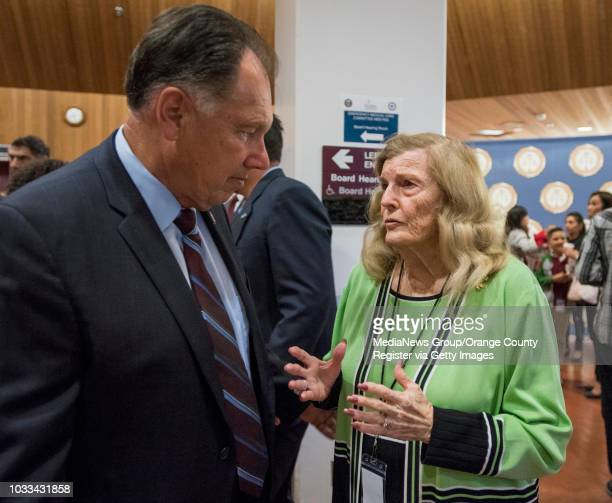 Orange County District Attorney Tony Rackauckas left speaks with Collene Campbell whose son Scott was murdered in 1982 prior to the start of the...