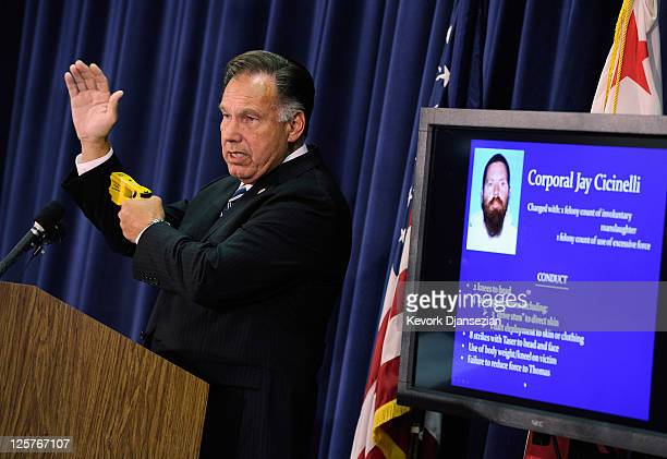 Orange County District Attorney Tony Rackauckas uses a taser gun to demonstrate how Fullerton police officer Cpl Jay Cicinelli used his weapon during...