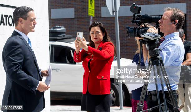 Orange County District Attorney's office Chief of Staff Susan Kang Schroeder records Orange County Supervisor Todd Spitzer following a press...
