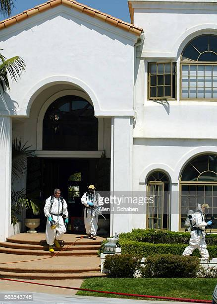 Orange County methamphetamine Lab multi–agency task force investigators emerge from a large Laguna Niguel home after 50 pounds of liquid and solid...