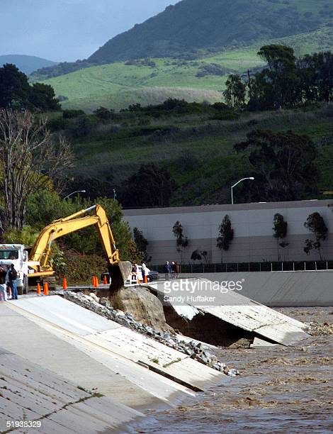 Orange County Public Works crews repair damage to a levee along the San Juan Creek January 11 2005 in San Juan Capistrano California Heavy rains have...