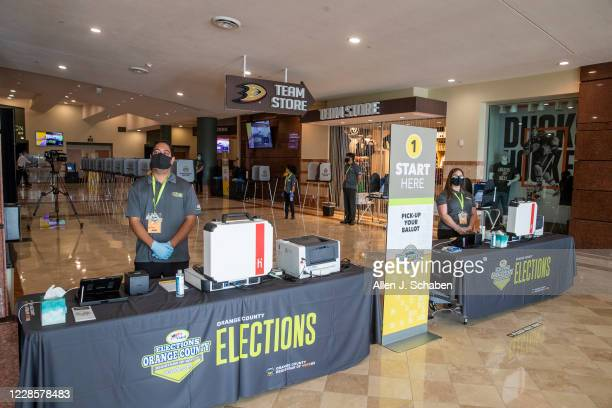 "Orange County Registrar of Voters election services workers stand by as the media gets a view of the ""Super Vote Center Site"" for walk-in and..."