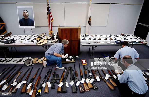 Orange County Sheriffs investigators examine guns owned by David Reza January 9 in Santa Ana CA Reza was arrested the previous day after allegedly...
