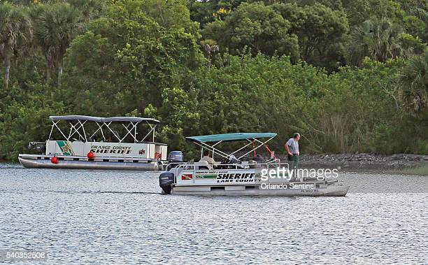 Orange County Sheriff's Marine Unit search for a young boy Wednesday June 15 2016 after the boy was grabbed Tuesday night by an alligator at Grand...