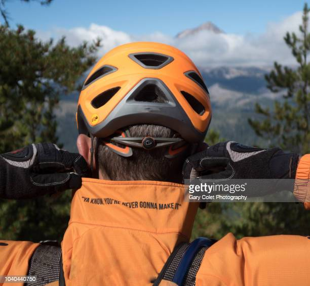 orange cycling jacket with amusing quotation - gary colet stock pictures, royalty-free photos & images
