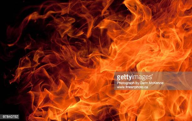 orange dancing flame - fire natural phenomenon stock pictures, royalty-free photos & images