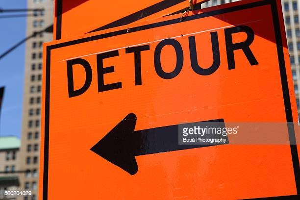 orange detour sign in the streets of nyc - detour sign stock photos and pictures