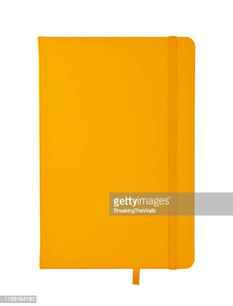 orange diary against white background - 手帳 ストックフォトと画像