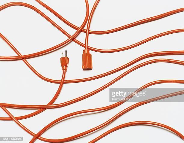 orange extension cord - cabo imagens e fotografias de stock