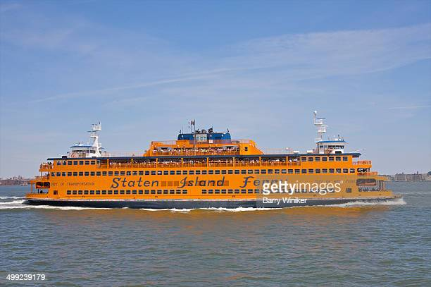 orange ferry boat profile - staten island ferry stock pictures, royalty-free photos & images