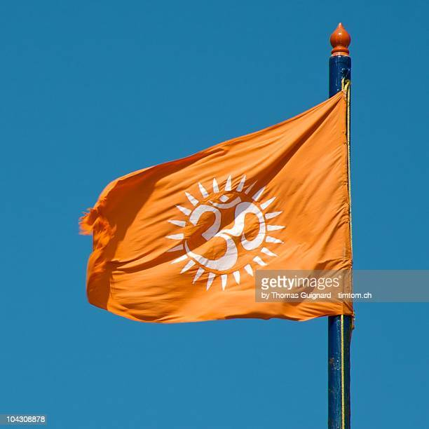 orange flag with ôm symbol - hinduism stock pictures, royalty-free photos & images
