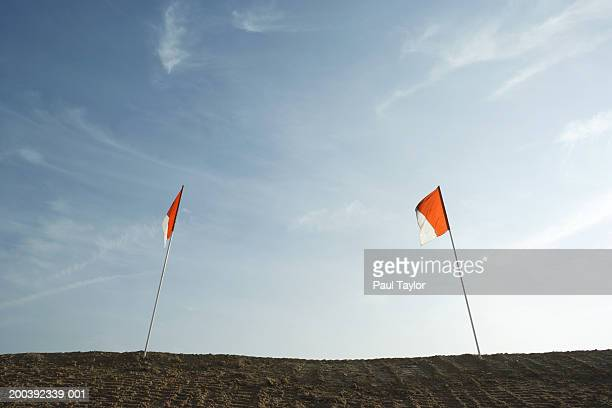 Orange flags at construction site