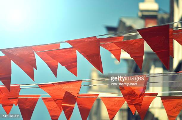 orange flags hanging on typical dutch houses in amsterdam - king's day netherlands stock pictures, royalty-free photos & images