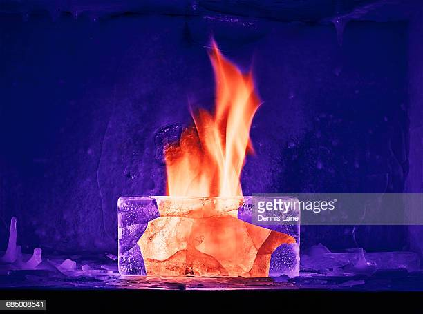 Orange flame burning in purple ice