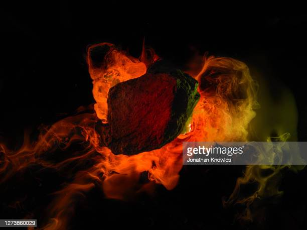 orange flames around rock - space and astronomy stock pictures, royalty-free photos & images