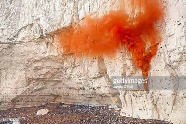 orange flare on chalk cliff