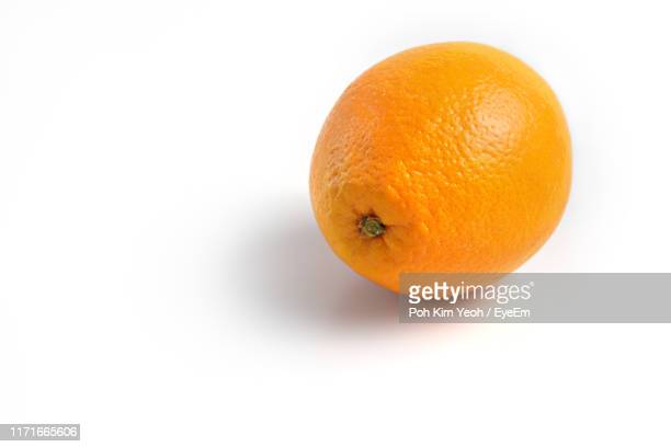 orange fruit against white background - orange stock pictures, royalty-free photos & images