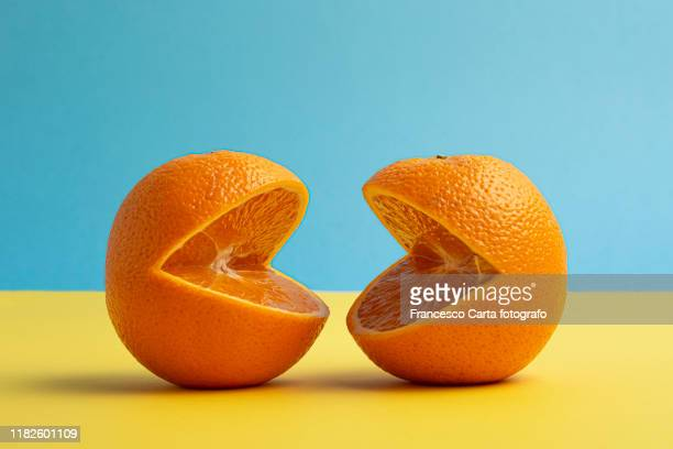 orange fruit - two objects stock pictures, royalty-free photos & images
