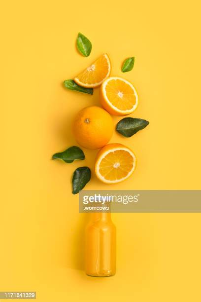 orange fruits and juice in bottle. - oranje stockfoto's en -beelden