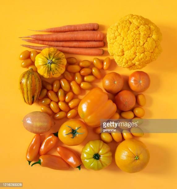 frutas y verduras de naranja - naranja color fotografías e imágenes de stock