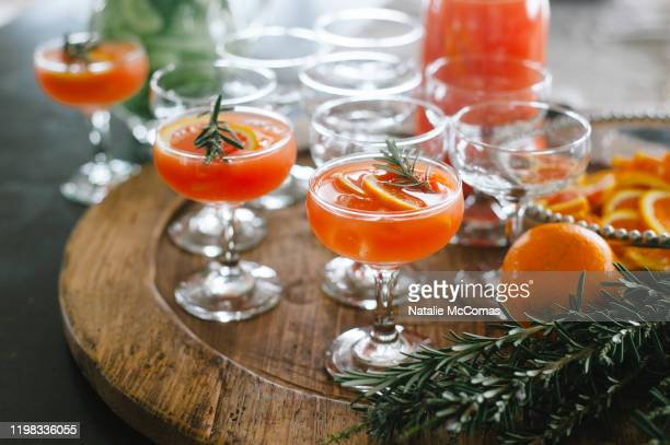 orange gin and tonic cocktails with rosemary - cocktail party stock pictures, royalty-free photos & images
