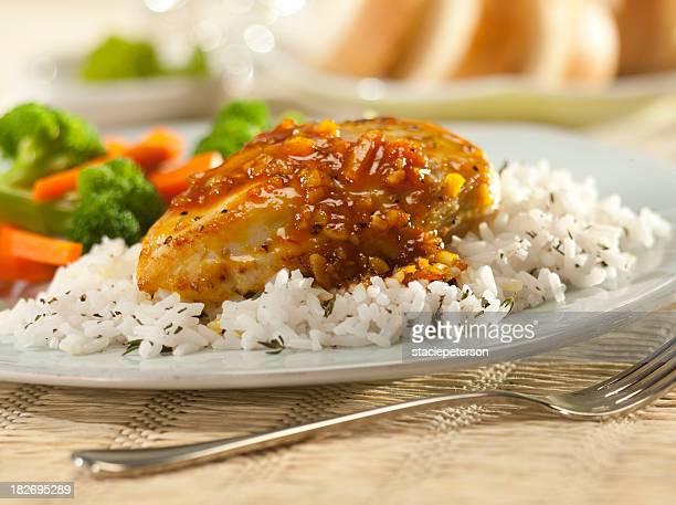 Orange glazed chicken breast with rice.