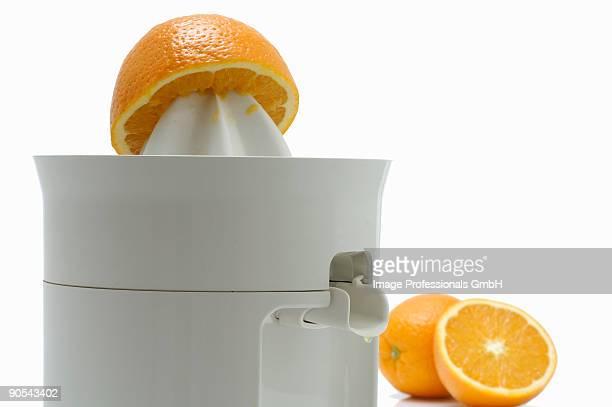 Orange half and juice squeezer, close up