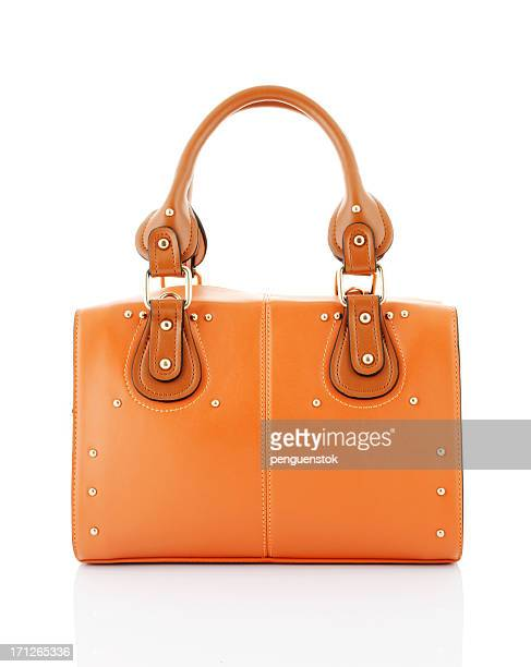 orange handbag - leather purse stock pictures, royalty-free photos & images