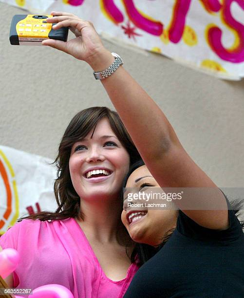 Orange High School student Beatrice Hidalgo holds up a camera and gets a snapshot of herself with actress and singer Mandy Moore at the charity...