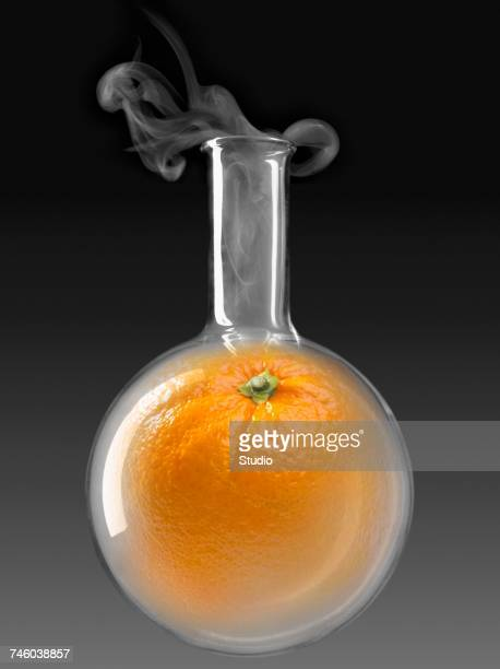 Orange in a glass chemical testing bottle