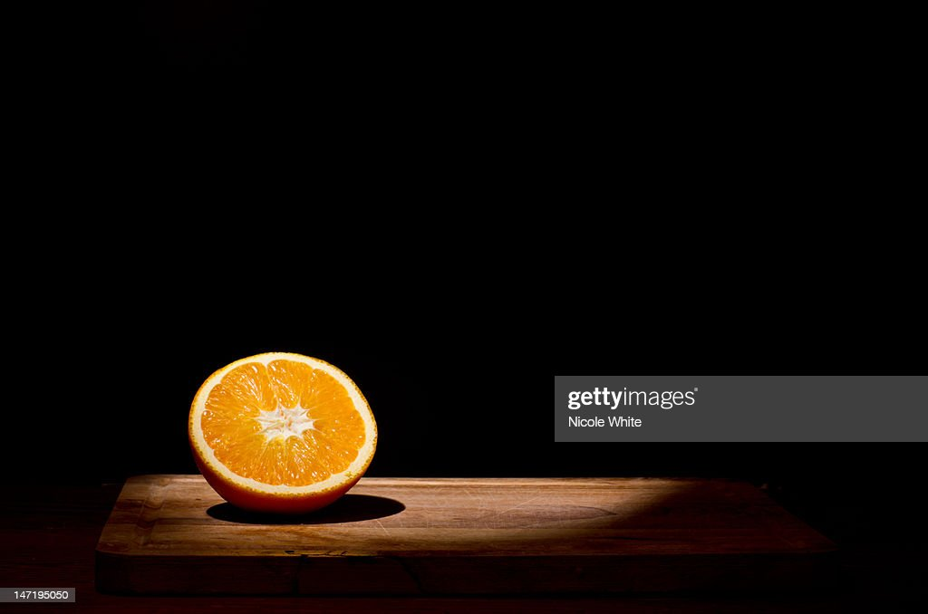 Orange in spotlight : Stock Photo