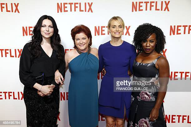 'Orange is the New Black' cast members US actresses Laura Prepon Kate Mulgrew Taylor Schilling and Uzo Aduba pose during a photocall for the launch...