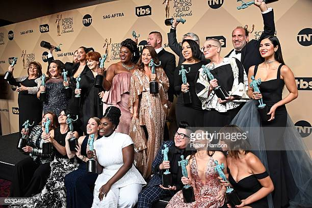 Orange Is the New Black cast members, winners of the Outstanding Performance by an Ensemble in a Comedy Series award, pose in the press room during...