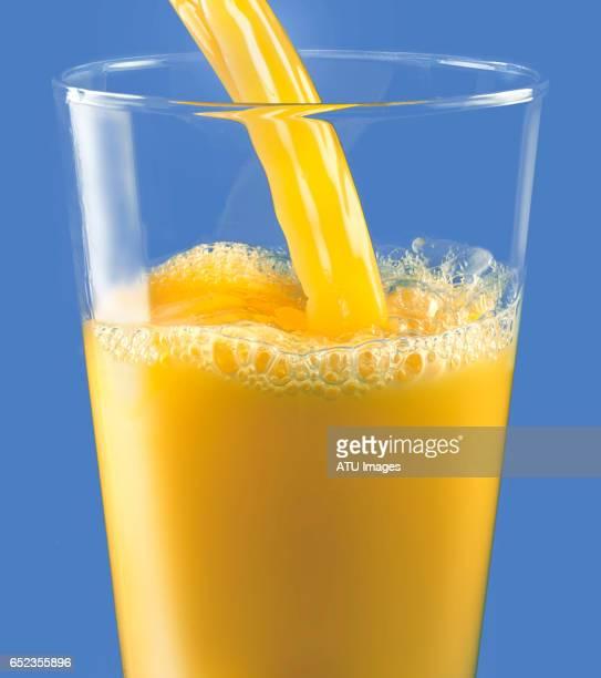 Orange juice on blue