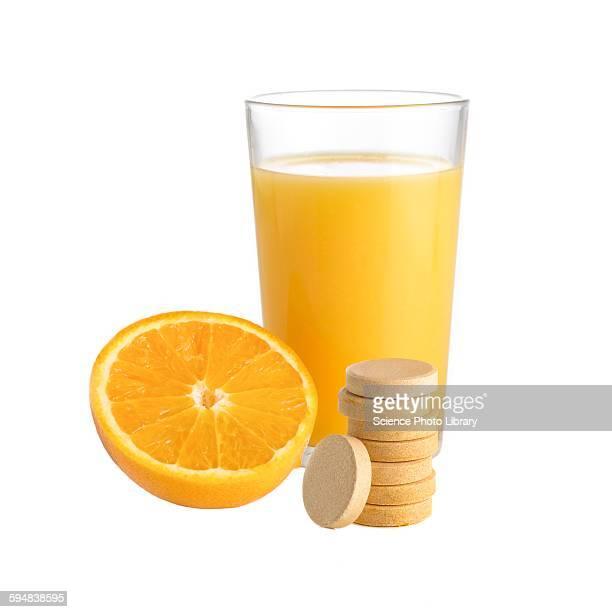 Orange juice, orange and vitamin c tablet