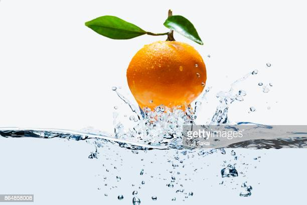Orange jump out from water.