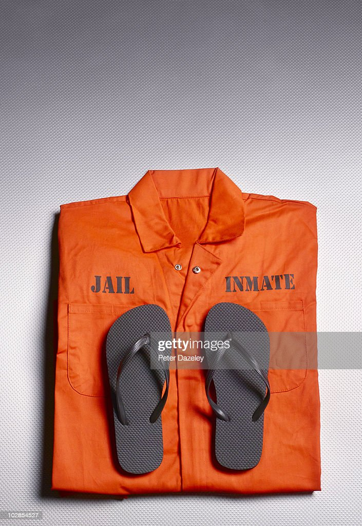 Orange jump suit in prison cell : Stock Photo