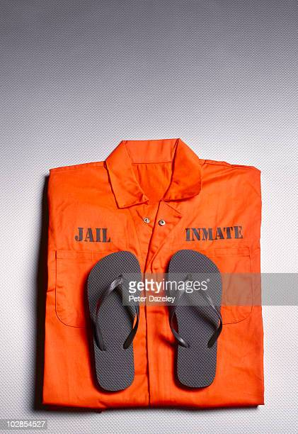 Orange jump suit in prison cell