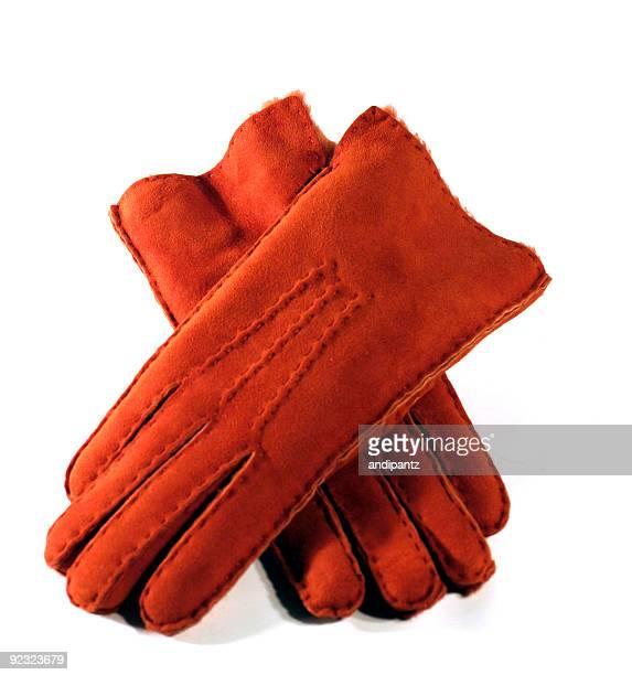 Orange leather gloves on white isolated background