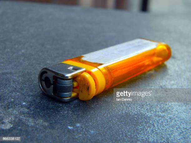 orange lighter - cigarette lighter stock pictures, royalty-free photos & images