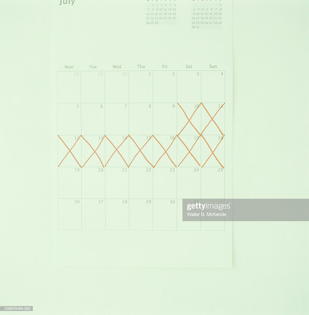 orange lines crossing out days on calendar ストックフォト getty images