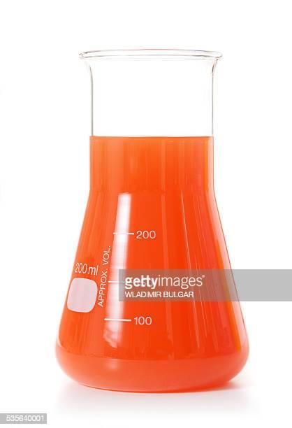 Orange liquid in a conical flask