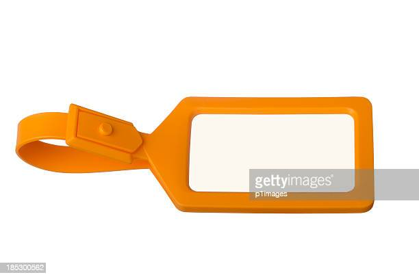 Orange luggage tag with copy space
