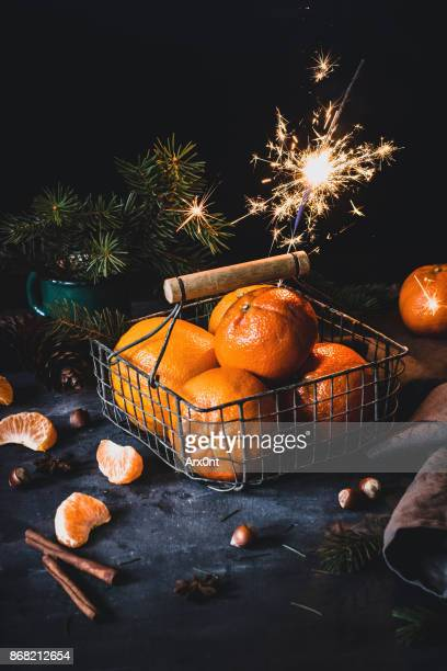 Orange mandarins with a Sparkler. Christmas food still life