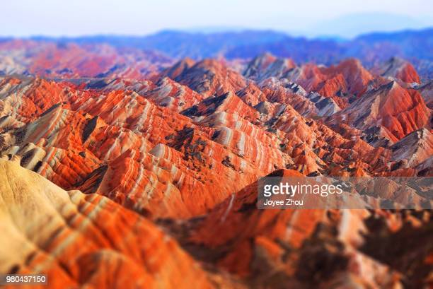 orange mountains in zhangye danxia national geological park, linze county and sunan county, china - 甘粛張掖国家地質公園 ストックフォトと画像