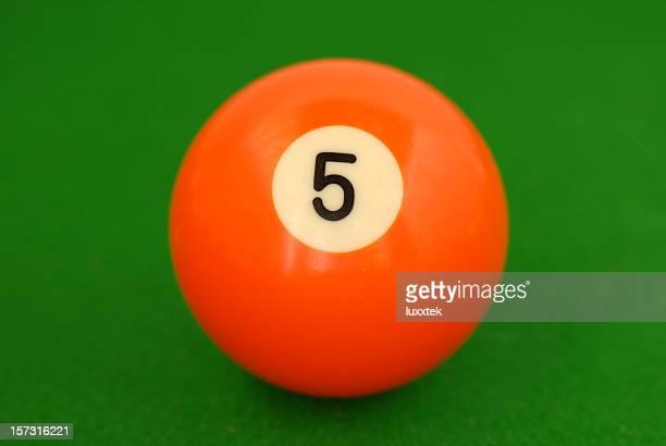 Orange number 5 billiard ball on green cloth